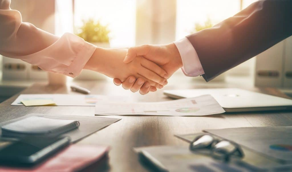 investing in real estate deal handshake