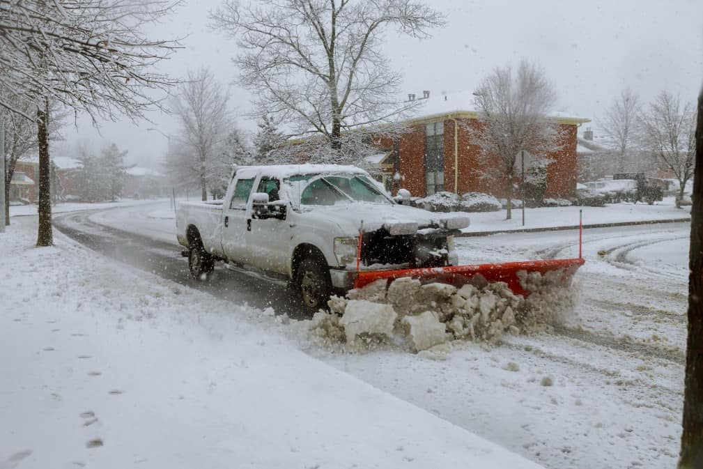 snow-plow-removing-snow-from-street-snowplow-trucks-removing-snow-on-the-road-street